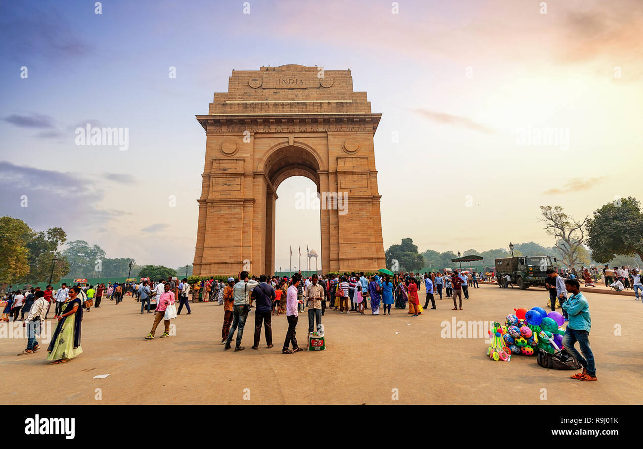 Tourists enjoy near India Gate historic war memorial Delhi at sunset. Stock Photo