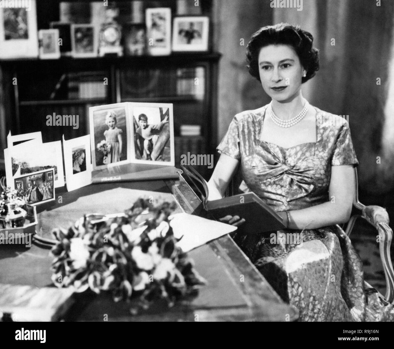 File photo dated 25/12/17 of Queen Elizabeth II in the Long Library at Sandringham shortly after making her Christmas Day broadcast to the nation. The monarch made her first Christmas broadcast live on the radio in 1952 Ð the year of her accession Ð and the annual message was first shown on TV in 1957. - Stock Image
