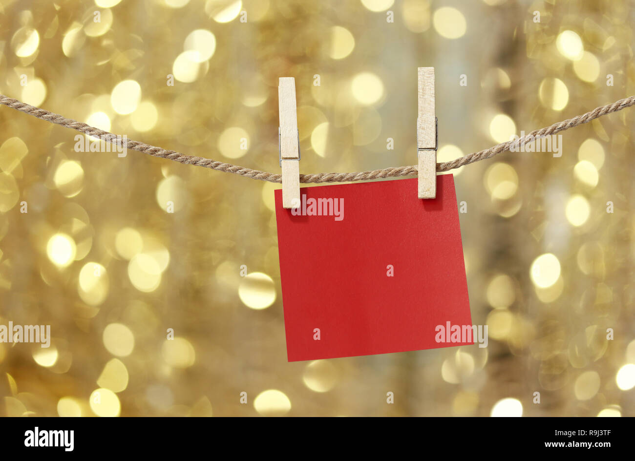 Blank Red Paper Notes Hanging On Clothesline For Design In
