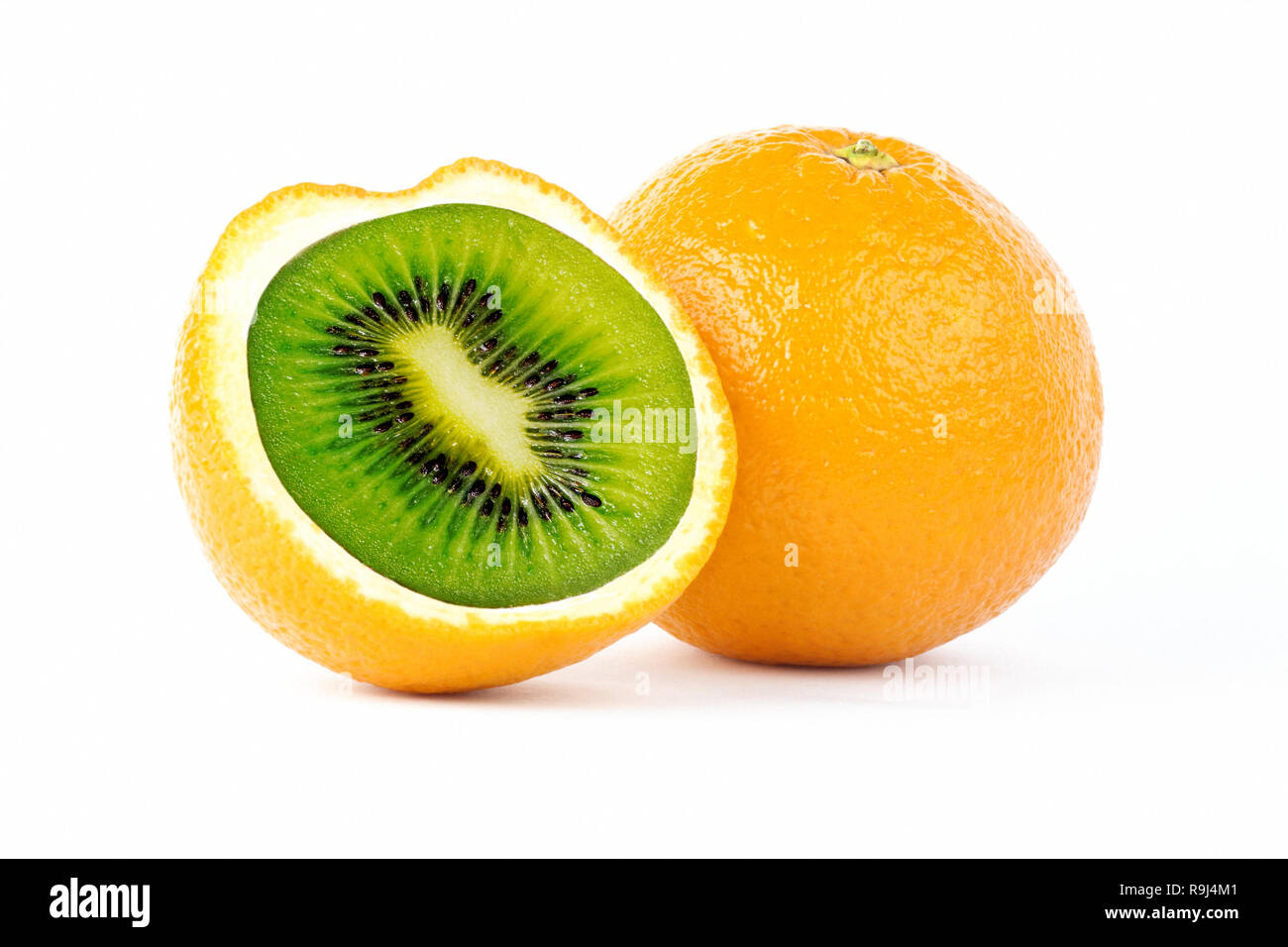 Creative photo manipulation of sliced orange with green kiwi inside isolated on white background - Stock Image