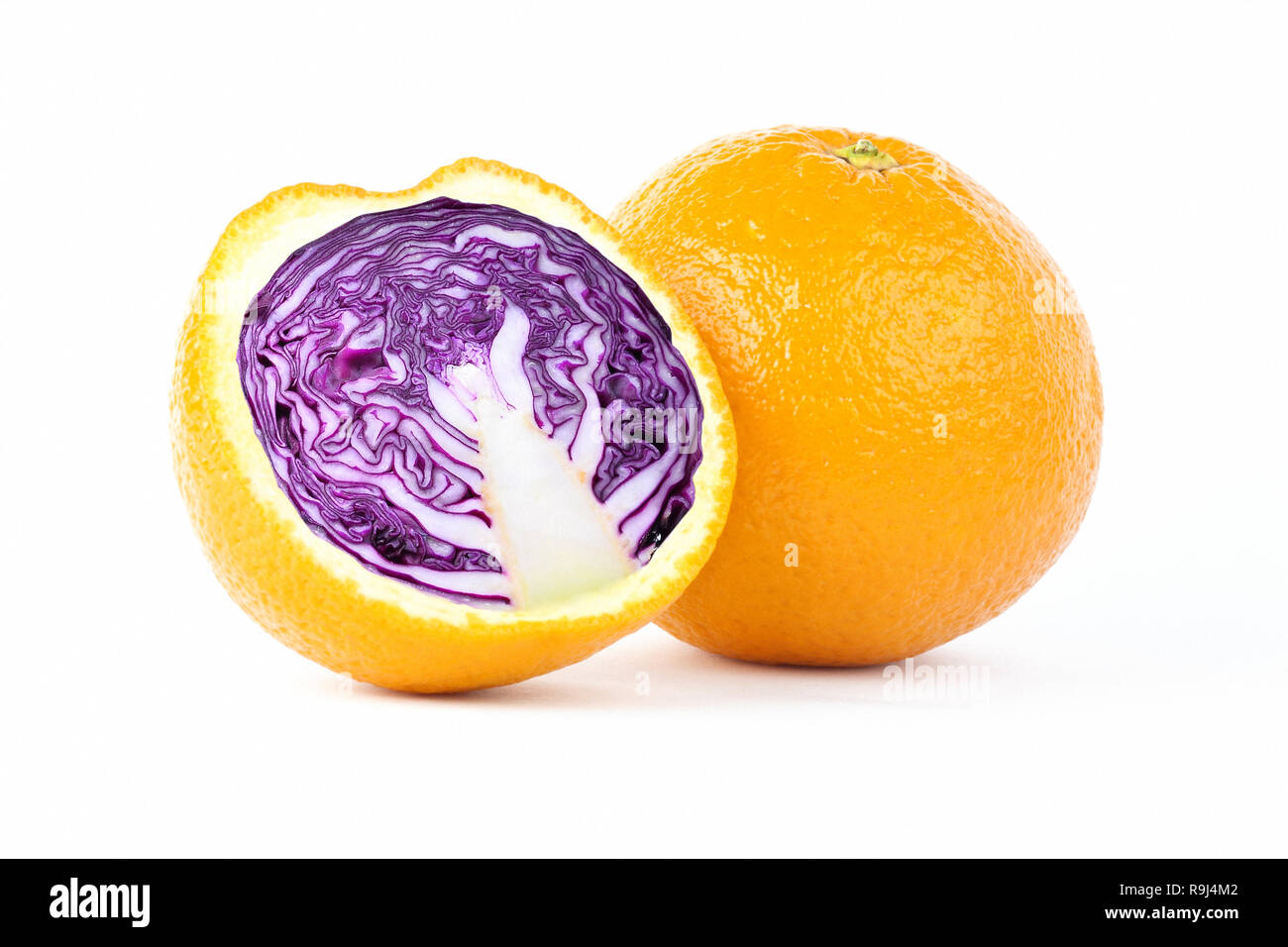 Creative photo manipulation of sliced orange with red cabbage inside isolated on white background - Stock Image