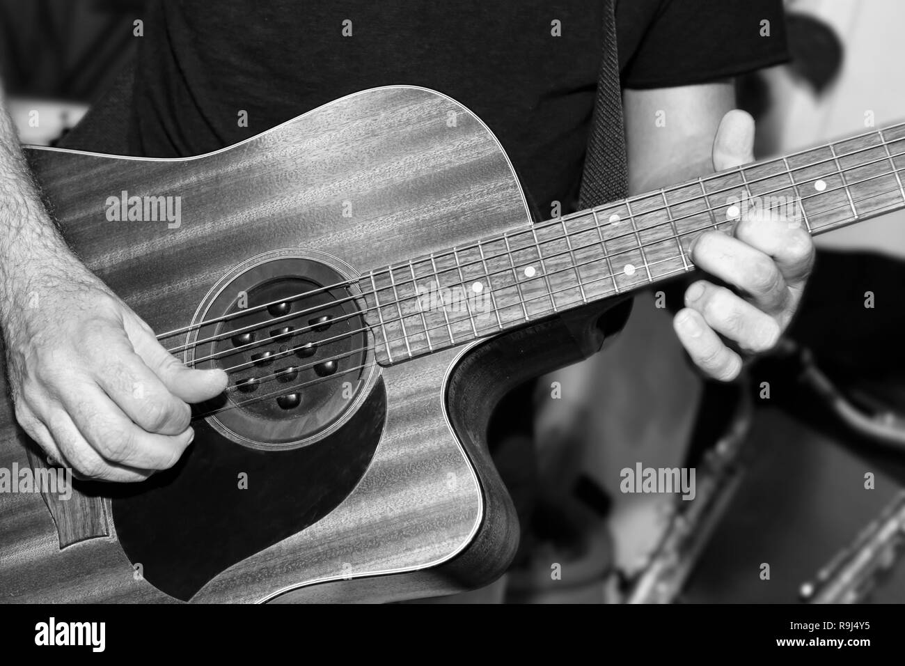 The guitarist plays a solo in the studio - Stock Image