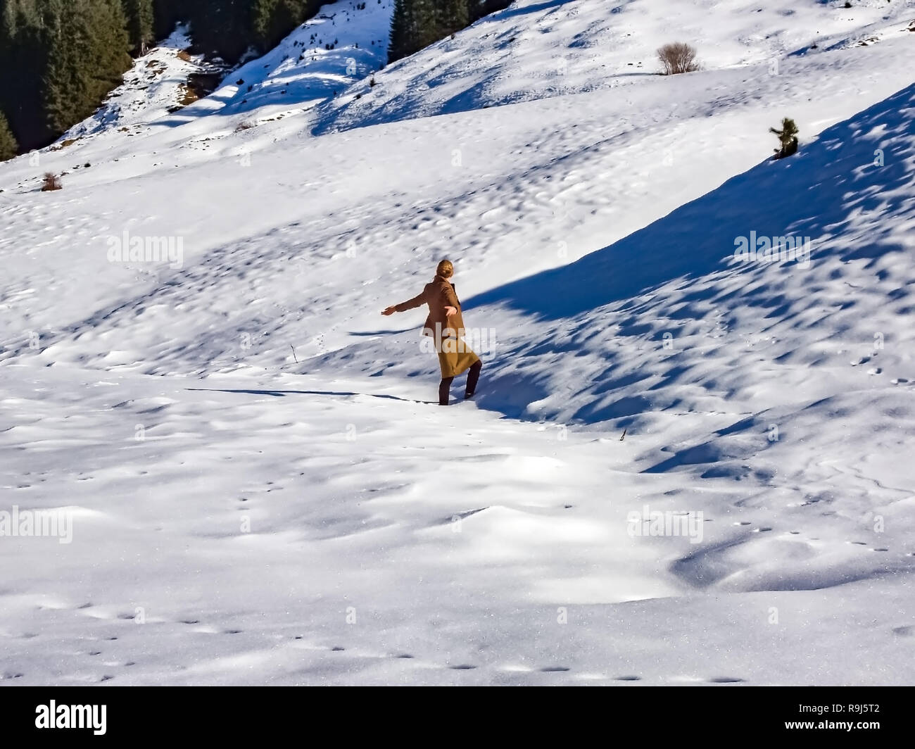 Fashion winter woman walking in the snow of the alps. Stock Photo