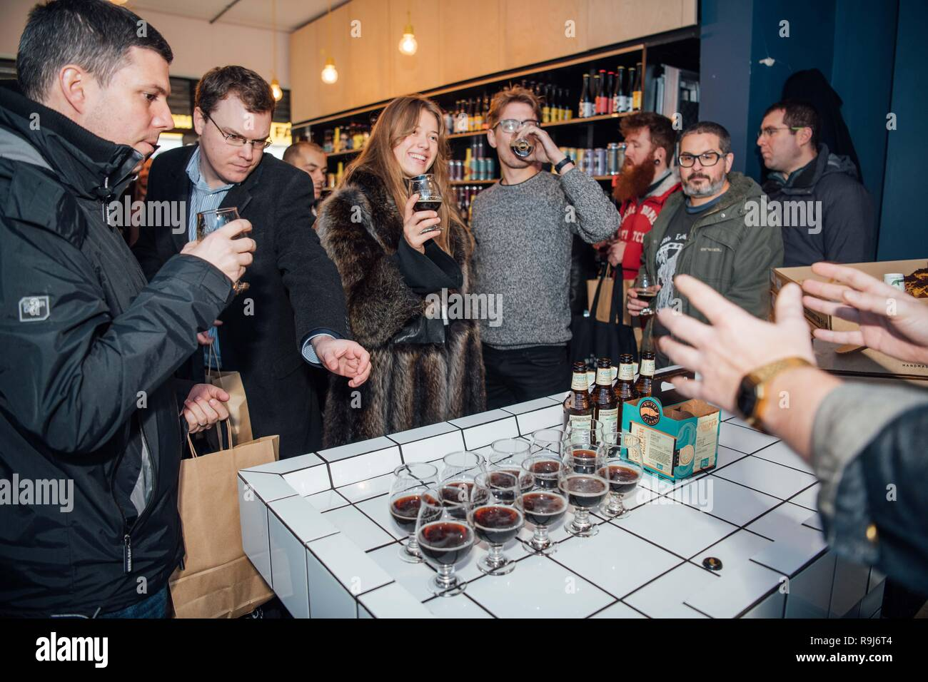 Eager beer lovers across London braved the cold for a £20 bottle of 2018 release of Goose Island's Bourbon County Stout (ABV 15.2%); an exclusive, limited run bourbon-barrel aged imperial stout. Fans in Shoreditch lined-up from 8:00am, indulging specially paired Crosstown doughnuts and an exclusive taste of Goose Island's Cooper Project Barrel-Aged Porter.  Featuring: Atmosphere Where: London, United Kingdom When: 23 Nov 2018 Credit: Scott Garfitt/PinPep/WENN.com - Stock Image