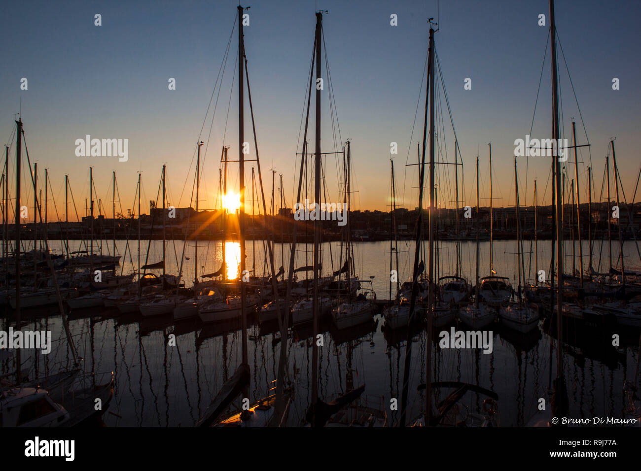 Sunset in the port of Catania - Stock Image