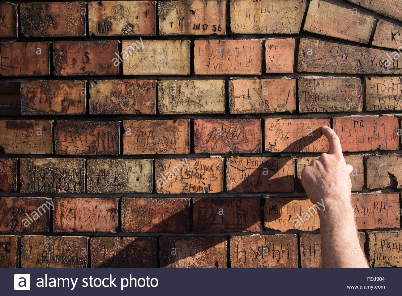 Bricks on wall with graffiti, Zemun, Belgrade, Serbia - Stock Image