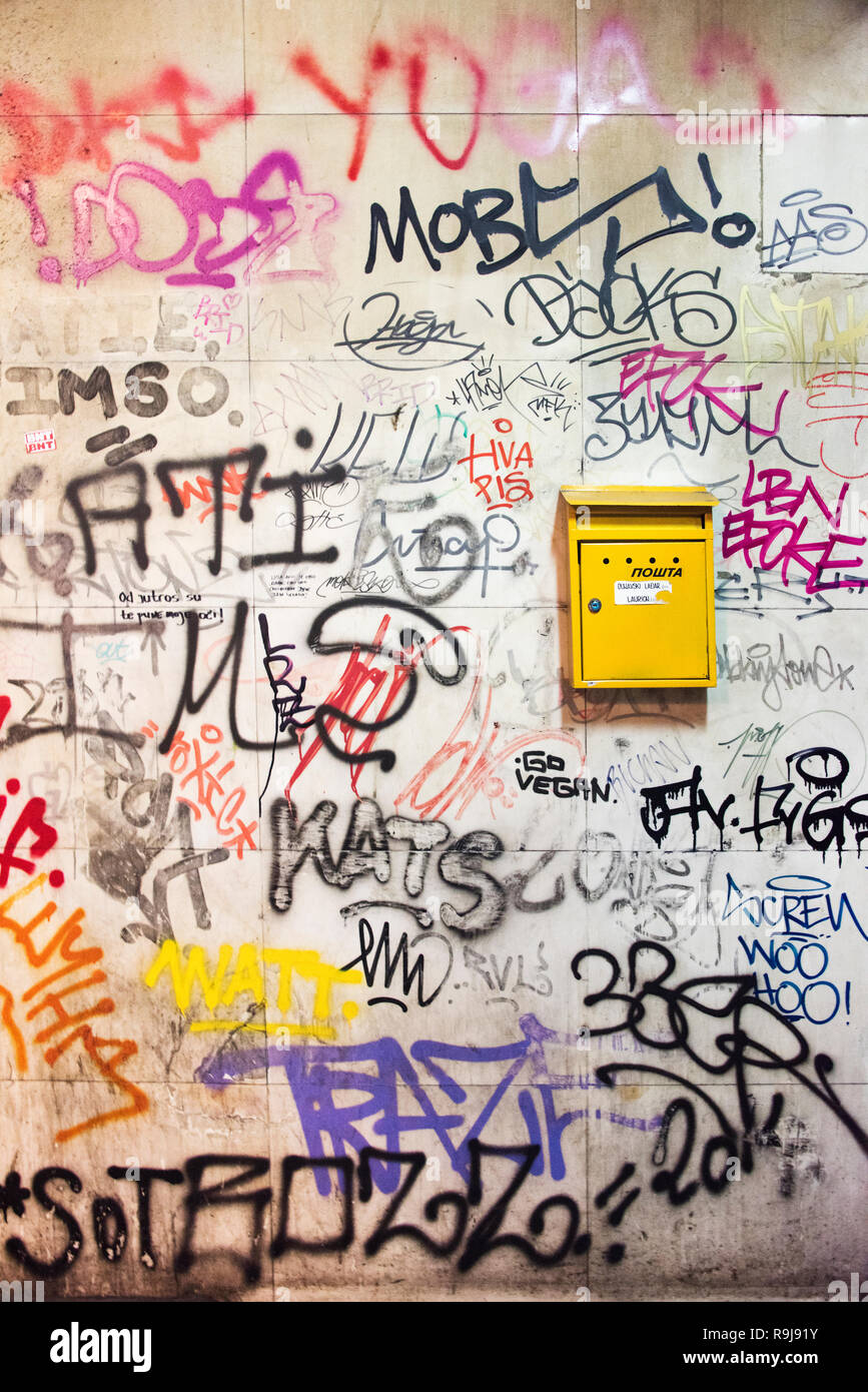 Mail box on the wall filled with graffiti, Belgrade, Serbia - Stock Image
