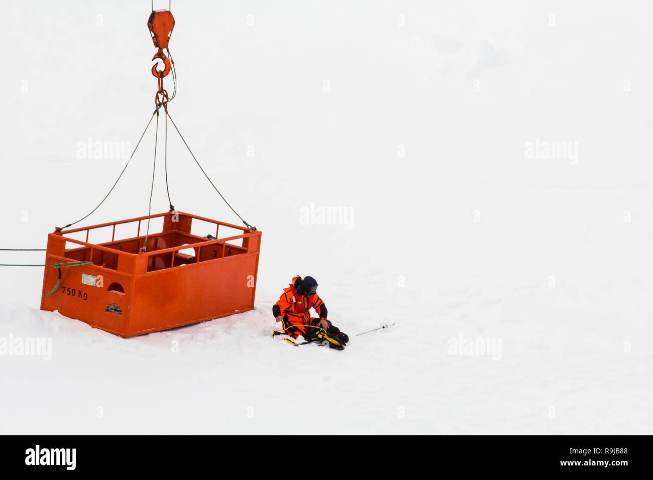 Weddell Sea, Antarctica – August 30, 2013: Scientists from research icebreaker Polarstern are measuring scientific parameters over an ice floe in emer - Stock Image
