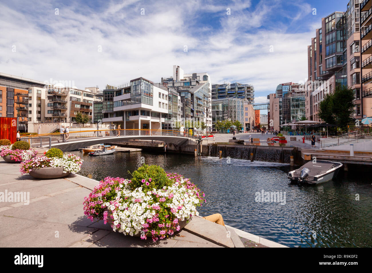 OSLO, NORWAY - JULY 23, 2018: Modern scandinavian architecture at renovated Aker Brygge neighbourhood, part of the Fjord City urban renewal project in - Stock Image