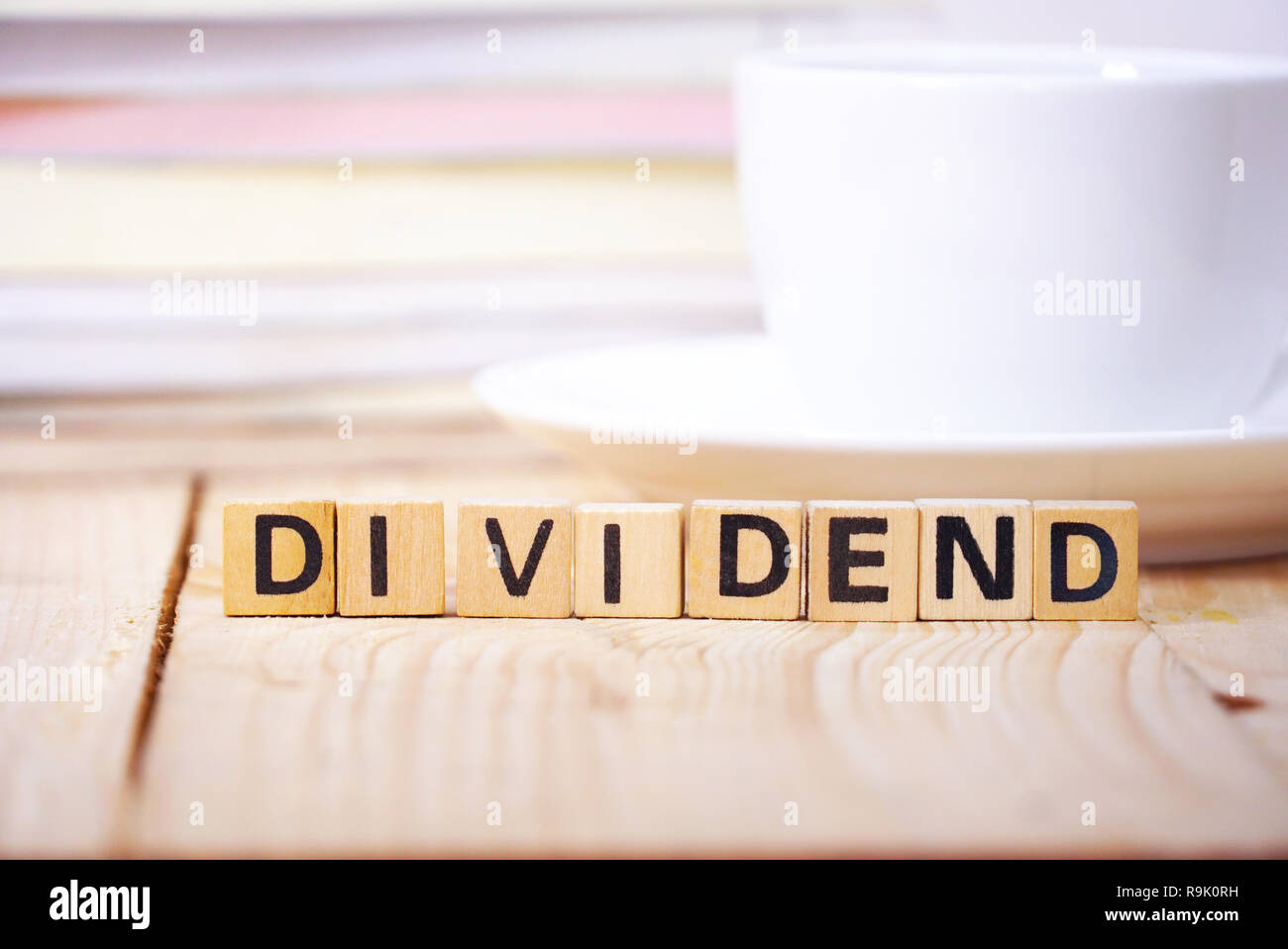 Text ' DIVIDEND 'on cube dice on working table , finance concept. - Stock Image