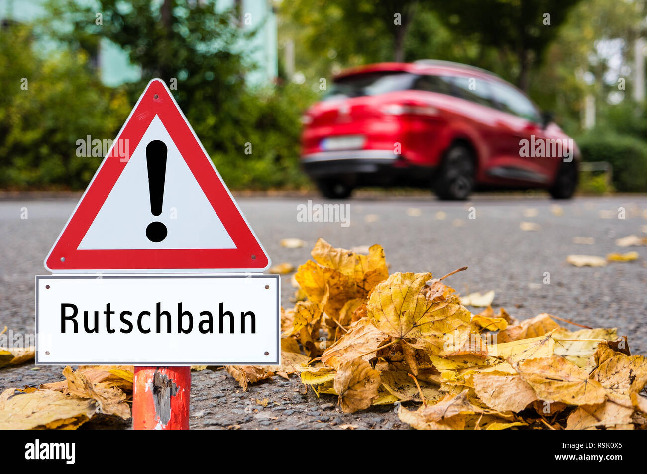 Caution slide sign - Stock Image