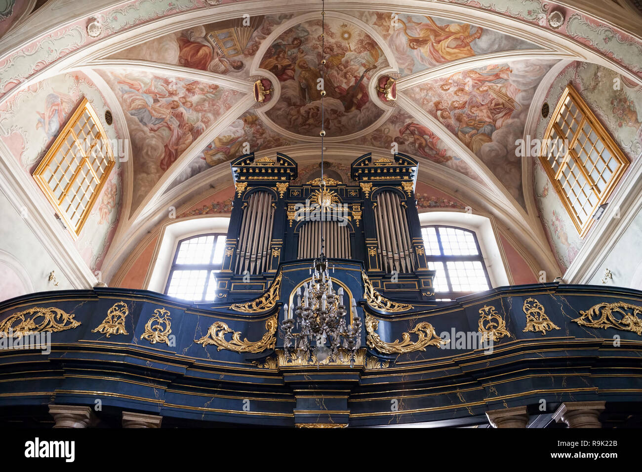 St. Barbara Church interior in Old Town of Krakow, Poland, pipe organ and Baroque vault with frescos - Stock Image