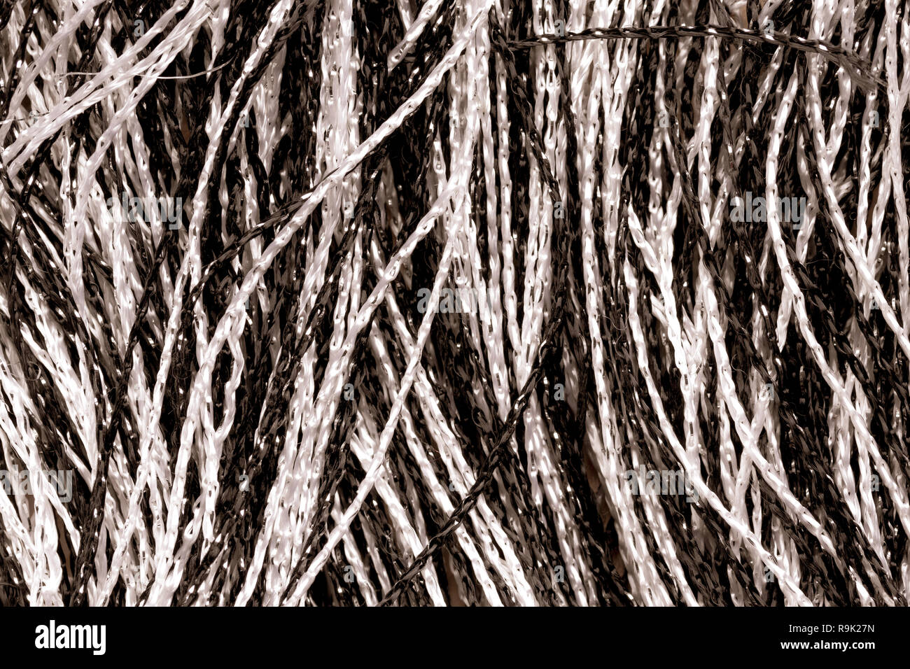 Fragment of a creative striped black and white fabric as a background texture an interesting design with a beautiful focus