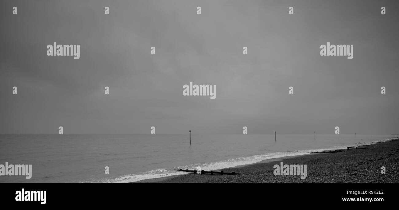 Navigation markers at the foreshore on a grey cloudy day in Bognor Regis, West Sussex, UK - Stock Image