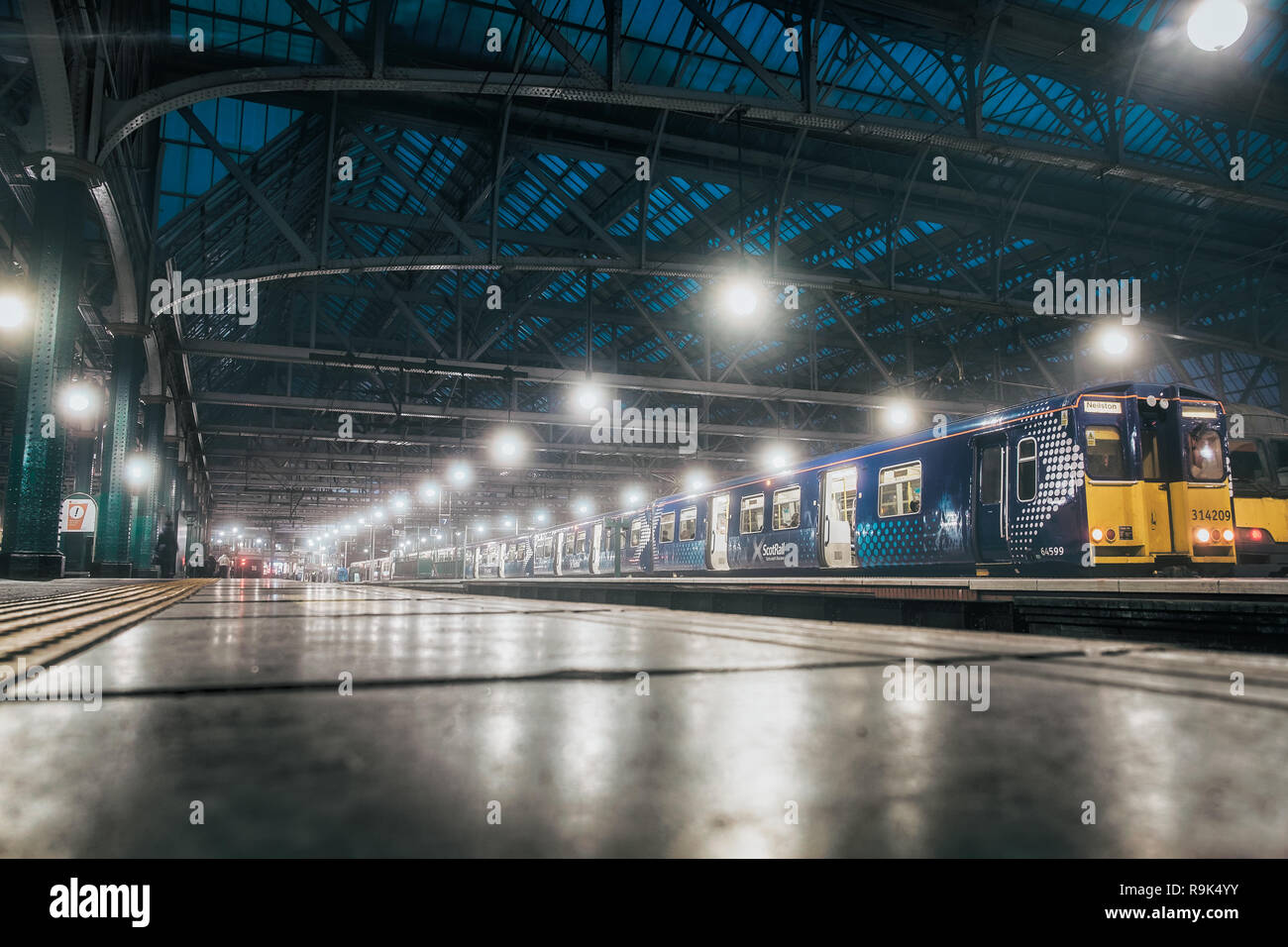 Glasgow central railway station. View from the lowest point on the station building and the train. Cold weather. Historic railway station and perspect - Stock Image