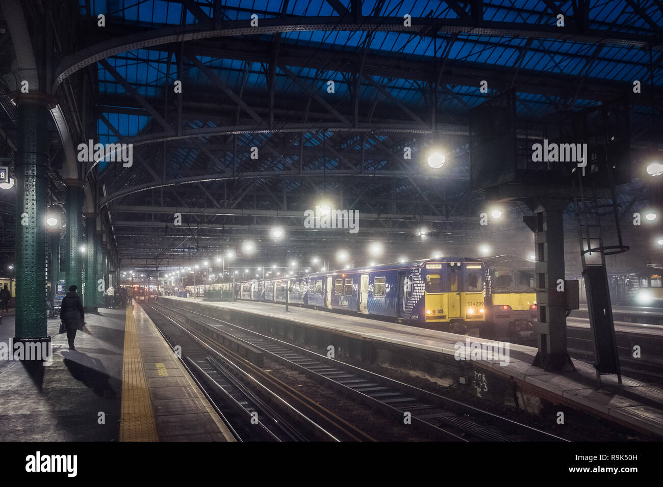 Glasgow central railway station. Train and rails in the station. Cold weather. Historic railway station and perspective view. Glasgow. United Kingdom. - Stock Image