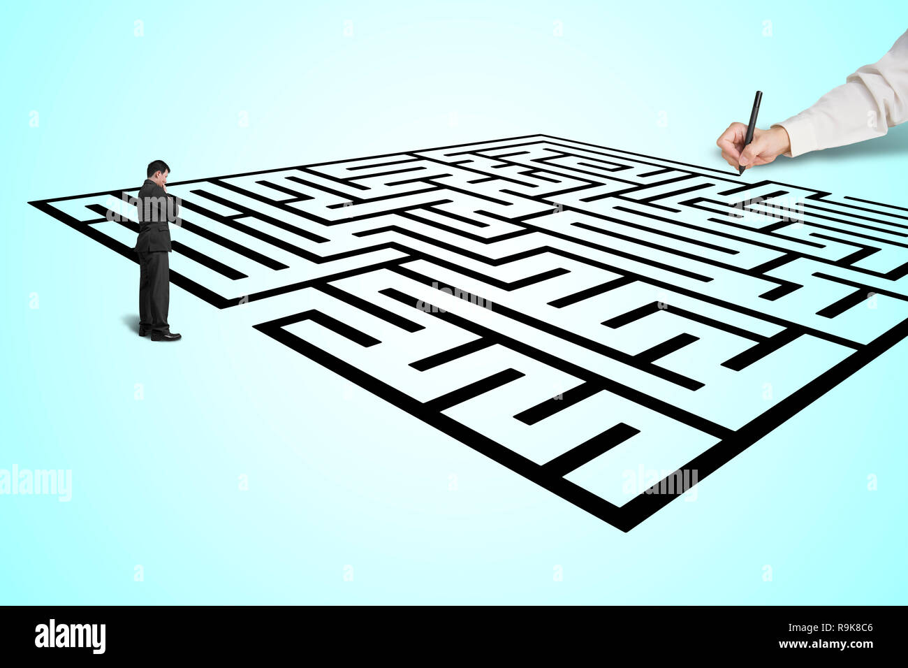 Hand drawing maze with thoughtful businessman standing in from, white background Stock Photo