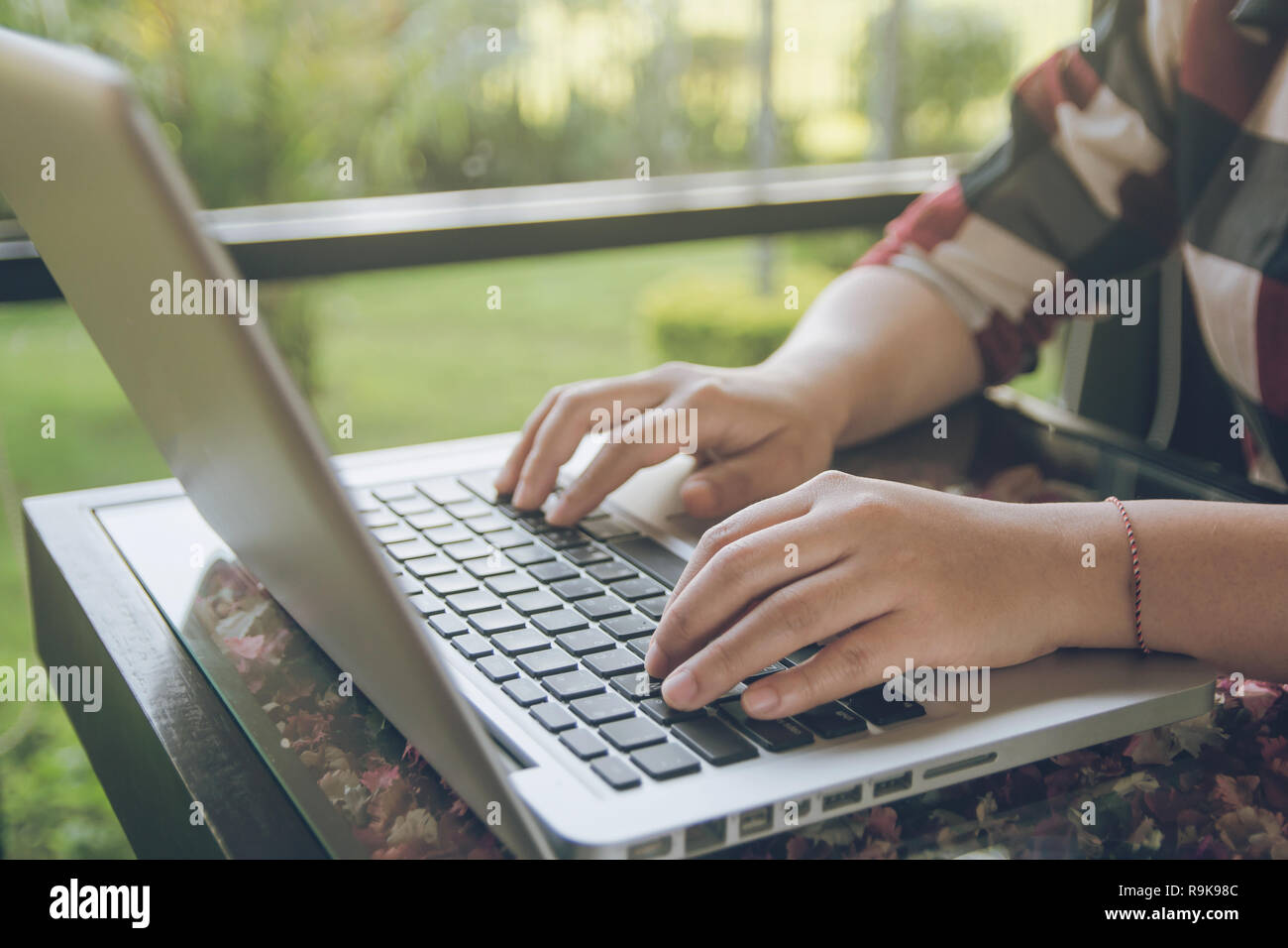Woman working on laptop. Close up hand Businesswoman working on Desk office business Stock Photo