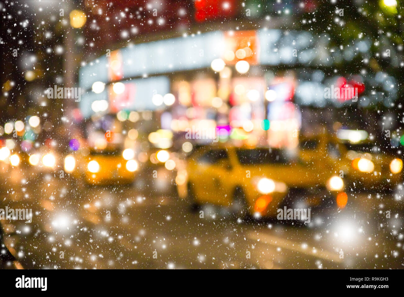6cf7b1f16707c Defocused blur New York City Manhattan street scene with yellow taxi cabs  and snowflakes falling during winter snow storm