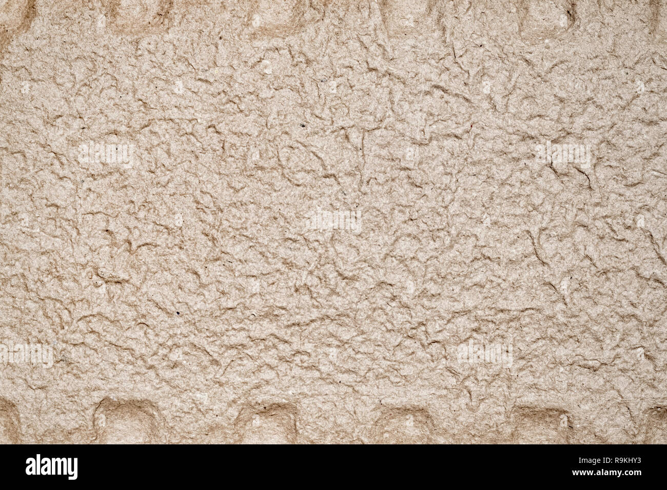 Uneven cardboard surface texture with fibers paper background monochrome - Stock Image