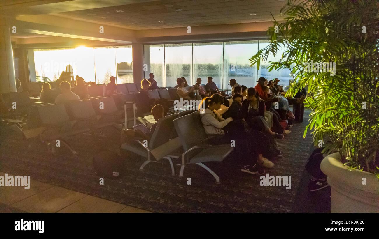Passengers in terminal at sunrise, Orlandom International Airport, FL - Stock Image