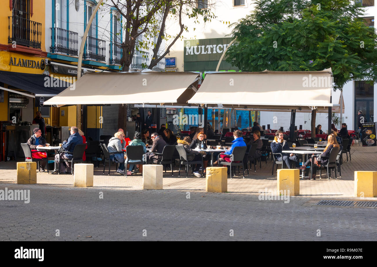 Outside tables filled with customers at an Alameda tapas bar in Seville, Spain - Stock Image