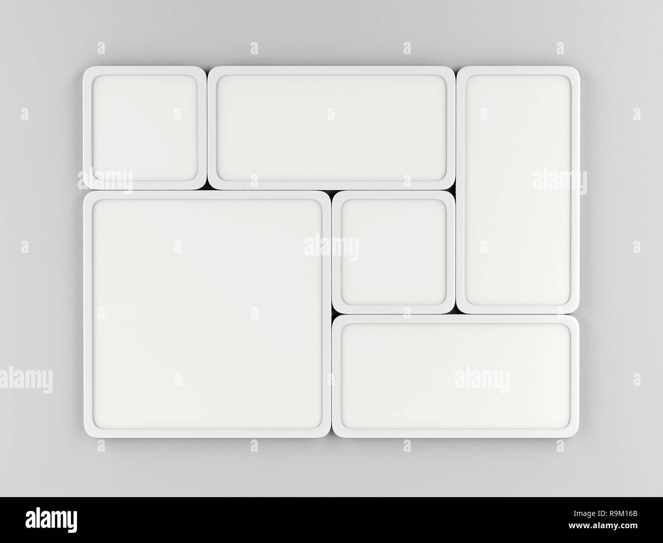 Group of white led panels on gray wall, front view - Stock Image