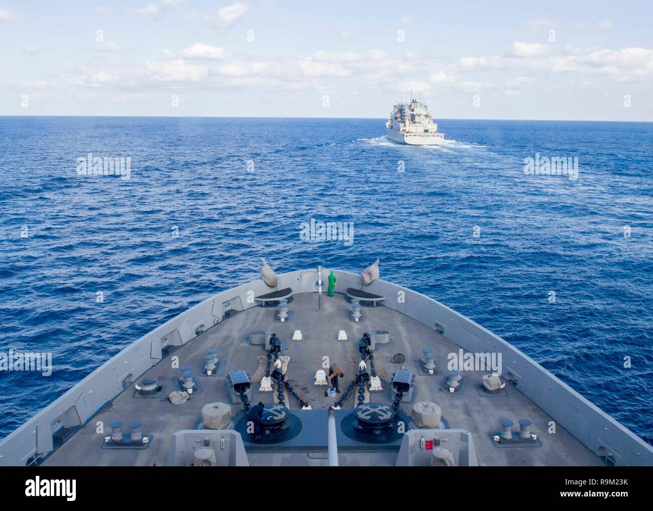 181114-N-PH222-1192 MEDITERRANEAN SEA (Nov. 14, 2018) The San Antonio-class amphibious transport dock ship USS Anchorage (LPD 23) transits the Mediterranean Sea behind the dry cargo and ammunition ship USNS Medgar Evers (T-AKE-13) in preparation for a replenishment-at-sea in, Nov. 14, 2018. Anchorage and embarked 13th Marine Expeditionary Unit are deployed to the U.S. 6th Fleet area of operations as a crisis response force in support of regional partners as well as to promote U.S. national security interests in Europe and Africa. (U.S. Navy photo by Mass Communication Specialist 3rd Class Ryan - Stock Image