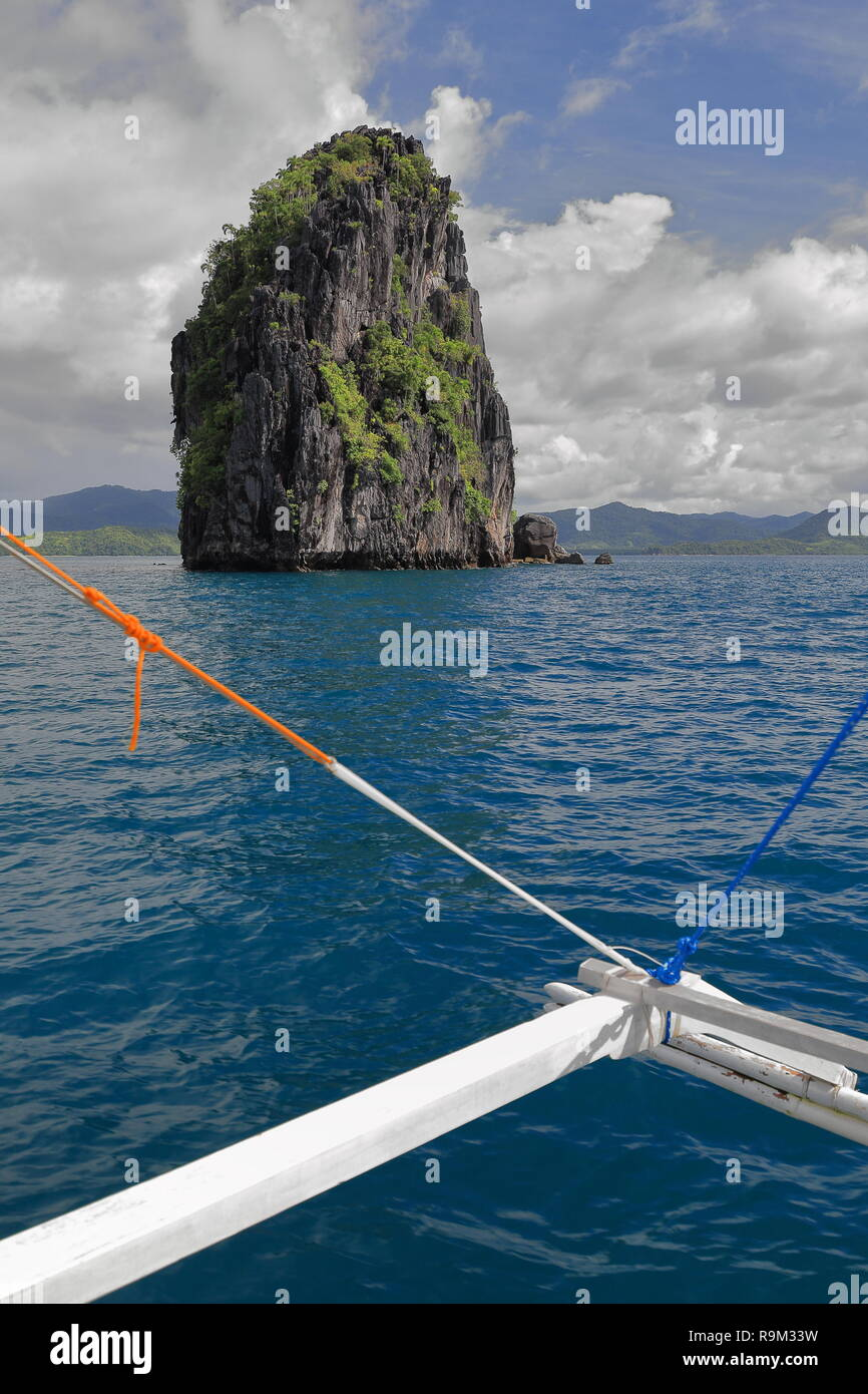 c1288dc1 Blue water-outrigger rigging of Filipino bangka tour boat facing Pinasil  island's southeastern tip-seat of Cathedral Cave-interior sometimes sunlit  th
