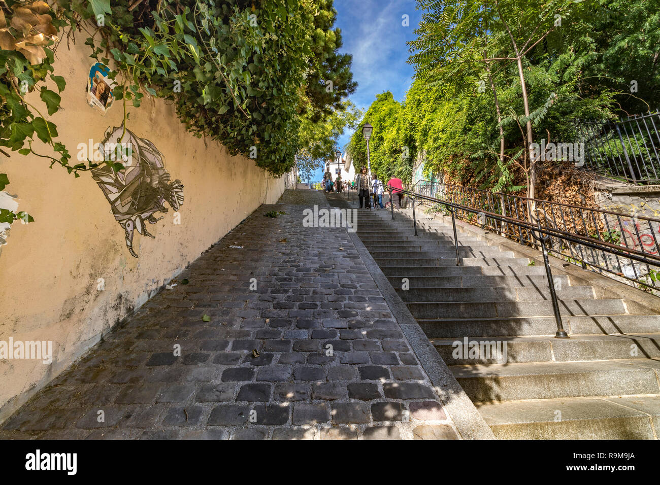 People climbing the Steep stairs at Rue Du Calvaire , connecting different street levels in Montmartre ,Paris Stock Photo