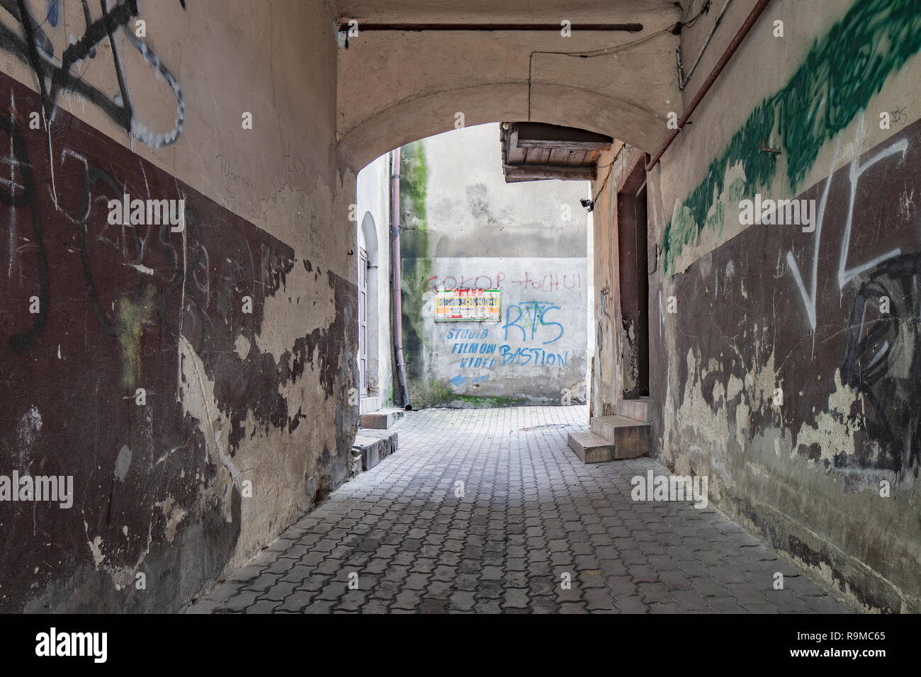 Old architecture in Piotrkow Trybunalski , a yard. City of the first jewish ghetto established by Germans in the occupied Poland during world war II. - Stock Image