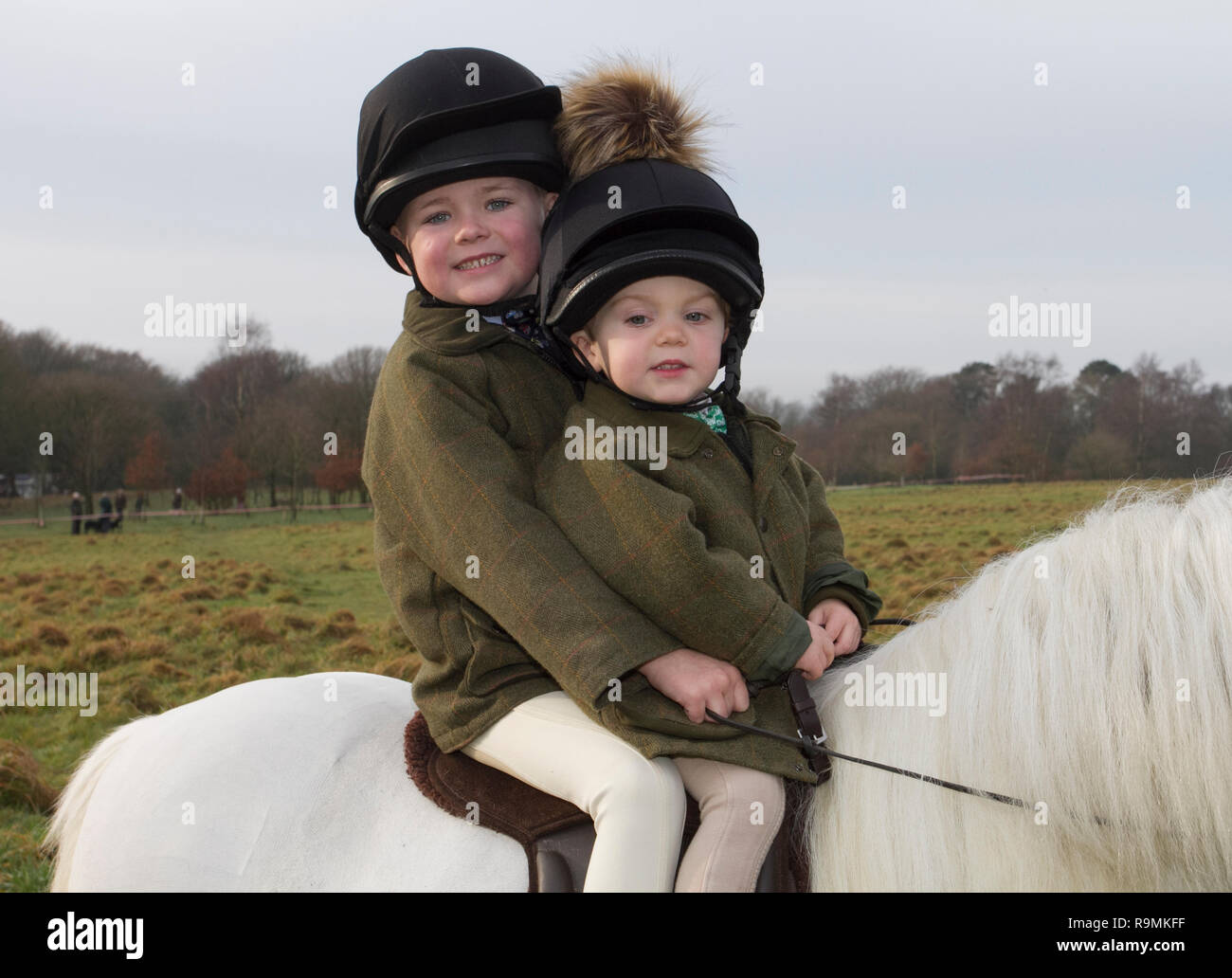Chorley, Lancashire, UK. 26th Dec. 2018. Walter aged 6 & Fred aged 2 years old at the Boxing day Hunt at Rivington. Horses and hounds returned to Rivington for Holcombe Hunt's traditional Boxing Day meet. Hundreds of spectators gathered to support the ride out, as they set off for a three-hour ride following the sound of the horn.  Hunting live quarry with dogs was banned in 2004, after the Speaker of the Commons invoked the Parliament Act to force the legislation through. Credit: MediaWorldImages/Alamy Live News - Stock Image