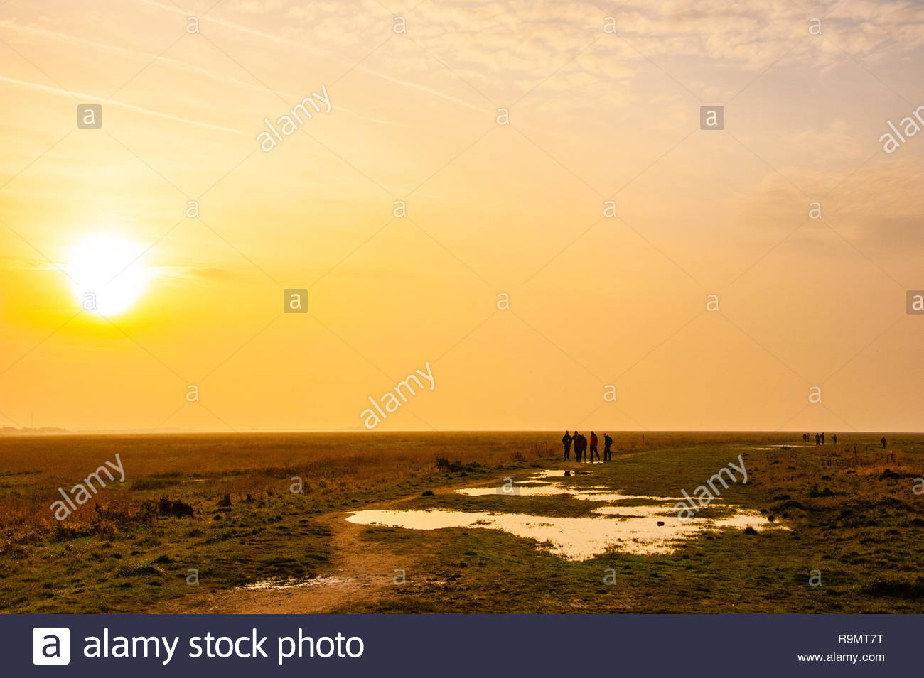 Southport, England, Uk, Europe. 26th Dec, 2018. UK Weather, Southport, Merseyside, England UK Boxing Day 26th December 2018. People walking off their Christmas excesses on a slightly misty Boxing Day afternoon at RSPB Marshside Nature Reserve as the light starts to fade in Southport, Merseyside, Lancashire, England UK Credit: Christopher Canty Photography/Alamy Live News Stock Photo