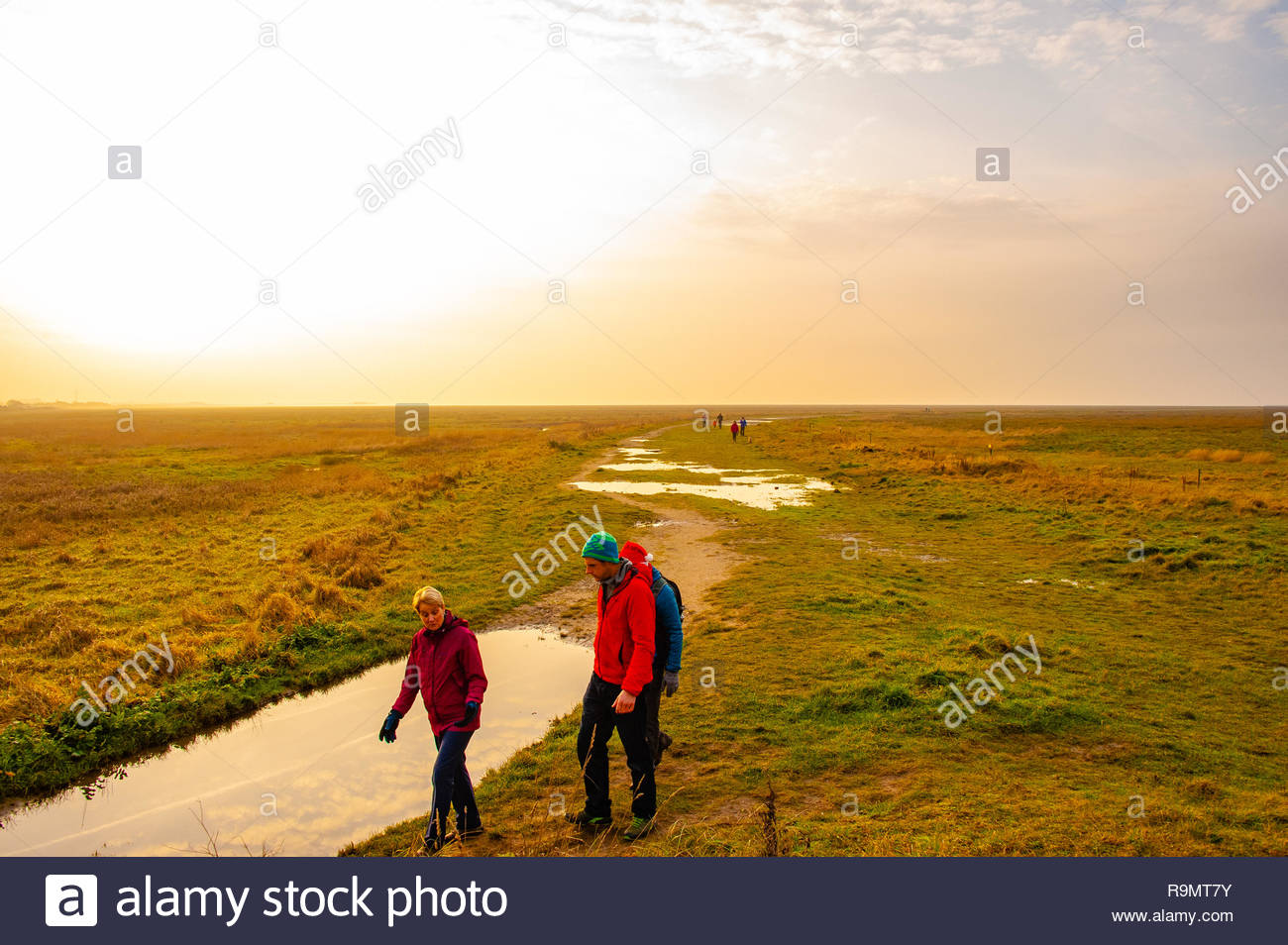 RSPB Marshside, Southport Beach, People walking off their Christmas excesses on a slightly misty Boxing Day afternoon at RSPB Marshside Nature Reserve as the light starts to fade in the Merseyside seaside town , Lancashire, England UK Credit: Christopher Canty Photography/Alamy Live News Stock Photo