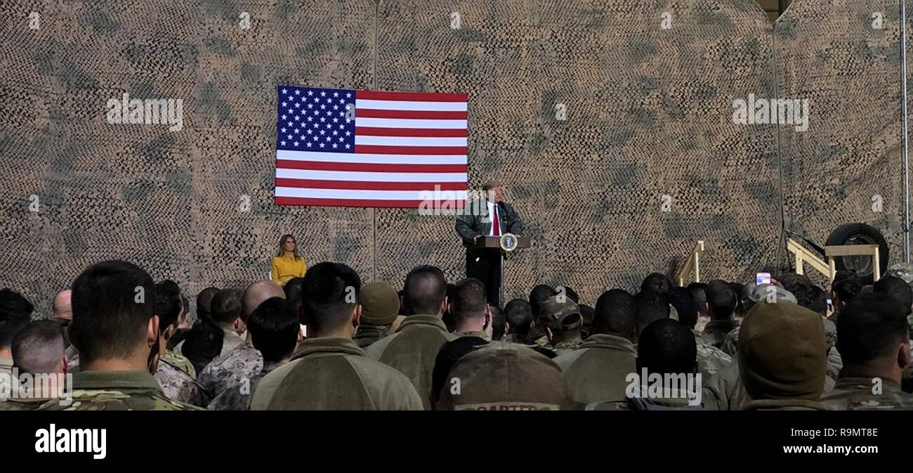 Al Anbar, Iraq. 26th Dec, 2018. U.S. President Donald Trump and First Lady Melania Trump address U.S. service members during a surprise to al-Asad Air Base December 26, 2018 in Al Anbar, Iraq. The president and the first lady spent about three hours on Boxing Day at Al Asad, located in western Iraq, their first trip to visit troops overseas since taking office. Credit: Planetpix/Alamy Live News - Stock Image