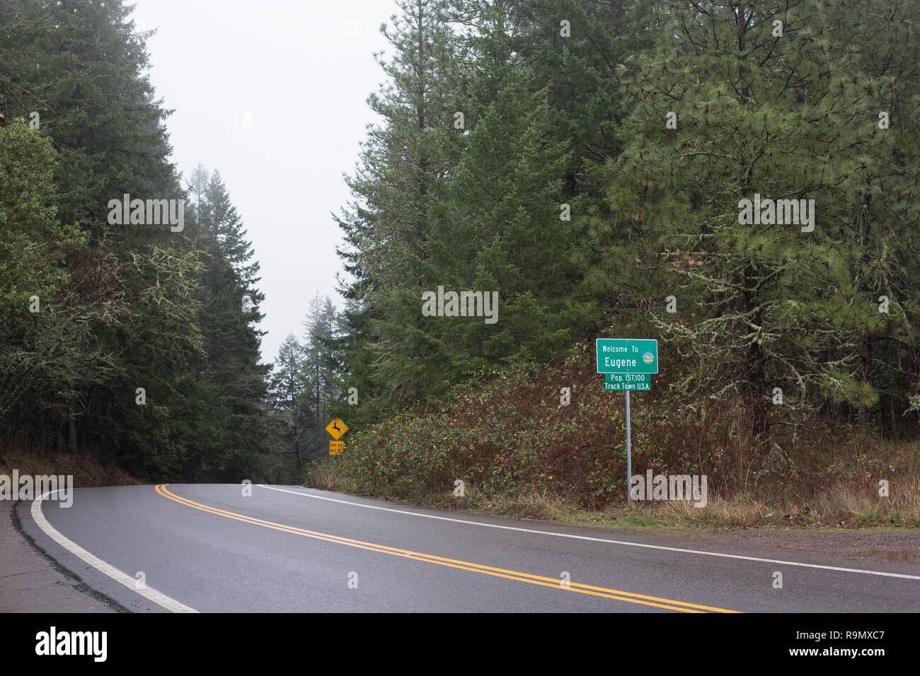 A city limits sign next to a rural highway in Eugene, Oregon, USA. - Stock Image