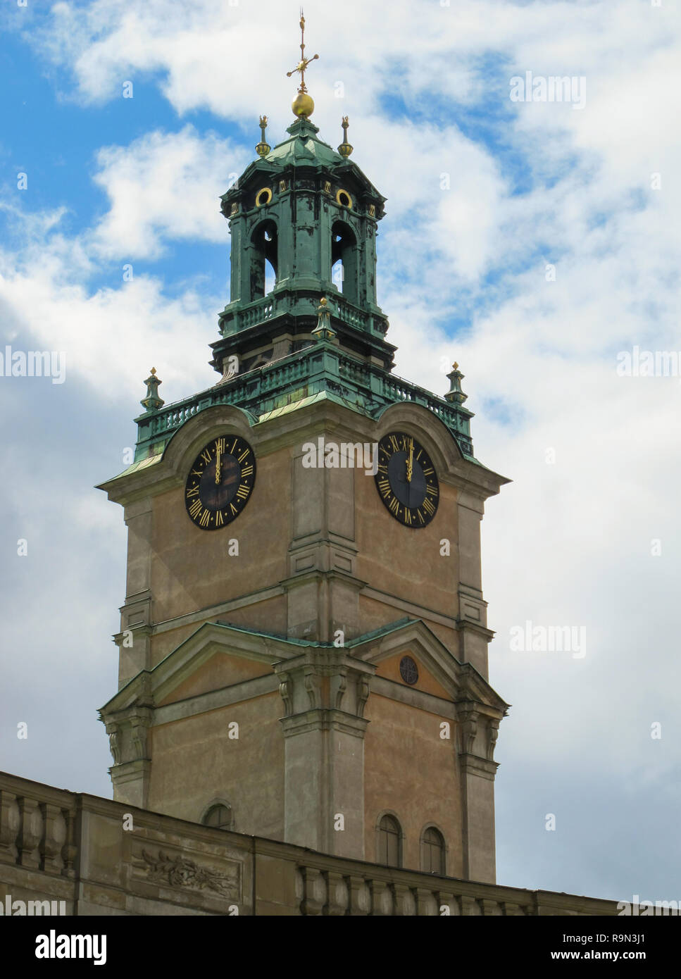 Vertical view of the bell tower of the Cathedral of St. Nicholas Storkyrkan at twelve o'clock. Stockholm, Sweden - Stock Image