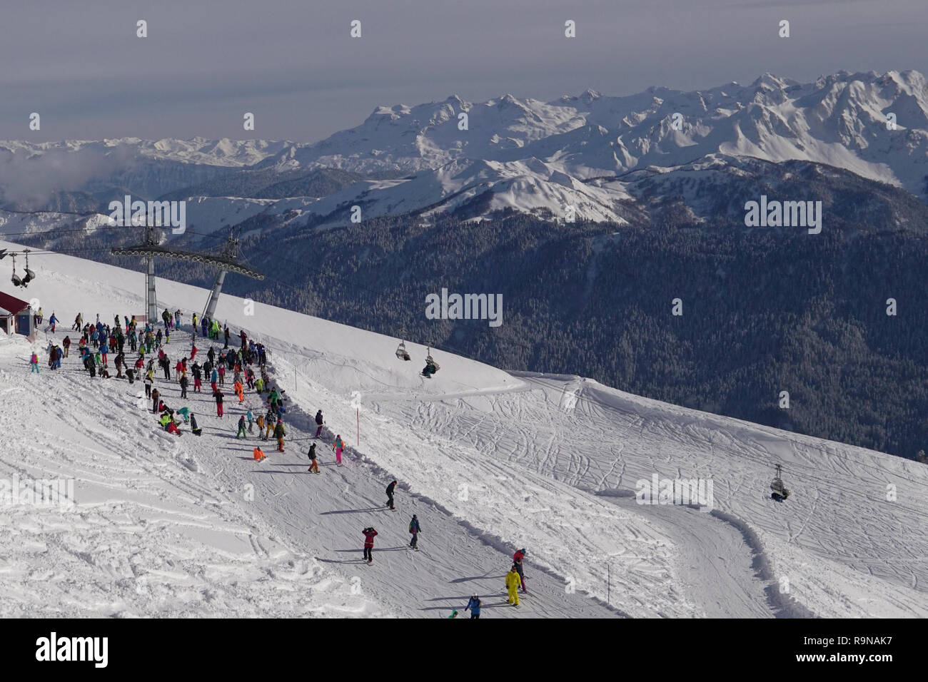 skiing, snowboarding and downhill skiing in the winter resort - Stock Image