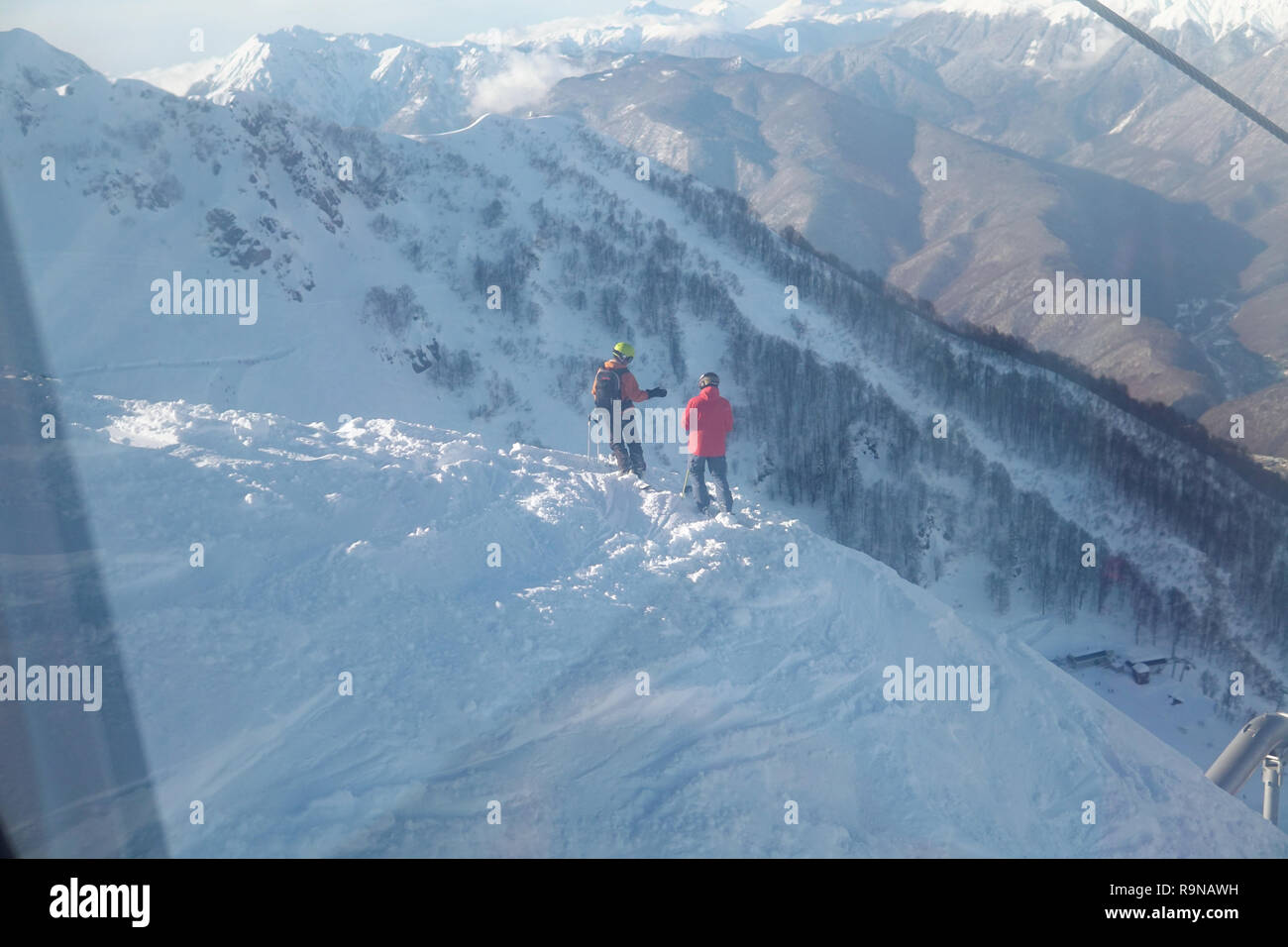 two skiers are on the precipice of the snow mountain Stock Photo