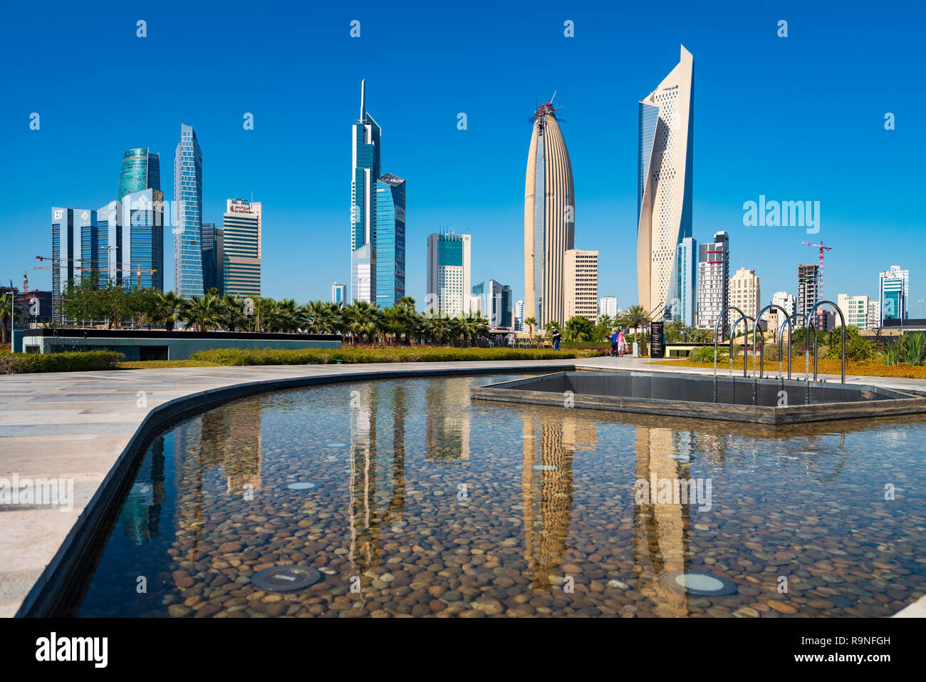 Daytime skyline of downtown Kuwait City from Al Shaheed Park in Kuwait, Middle East - Stock Image