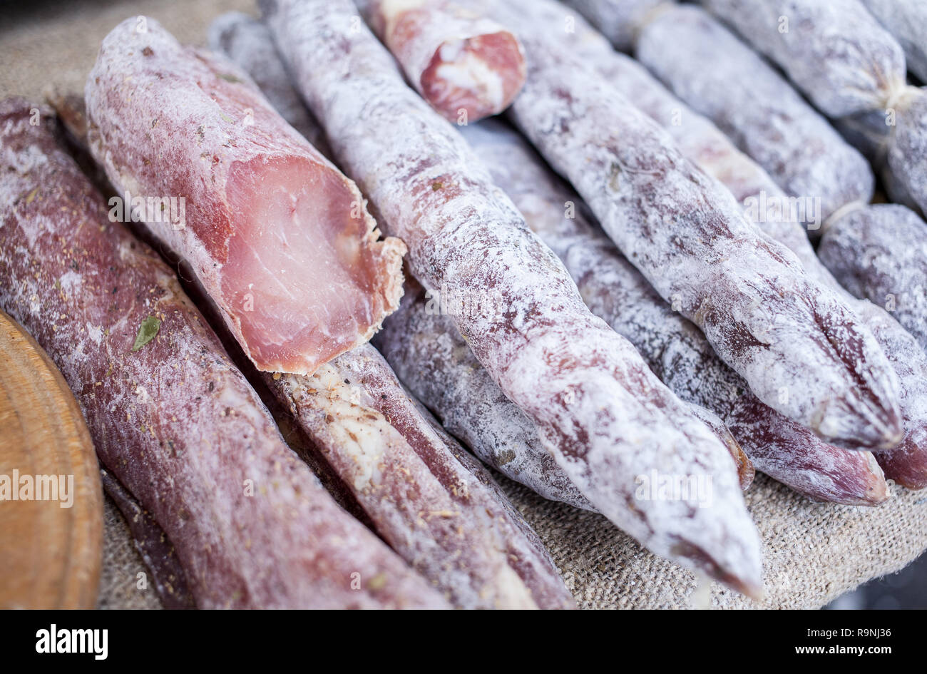 Traditional sausage is dry in market. A lot of smoked sausage in the store. Gastronomic products for gourme. Handmade - Stock Image
