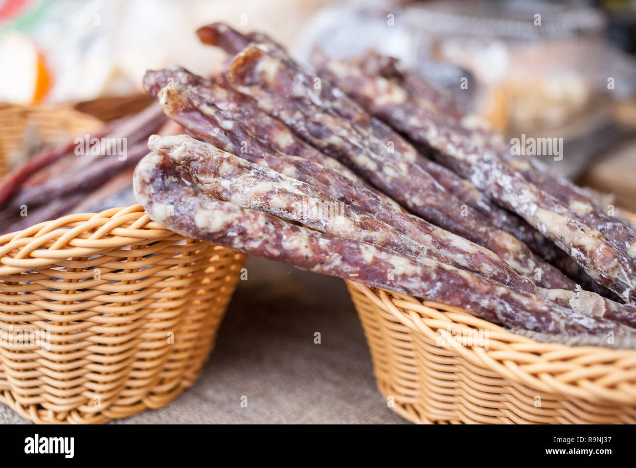 Traditional sausage is dry in market. Gastronomic products for gourme. Handmade - Stock Image