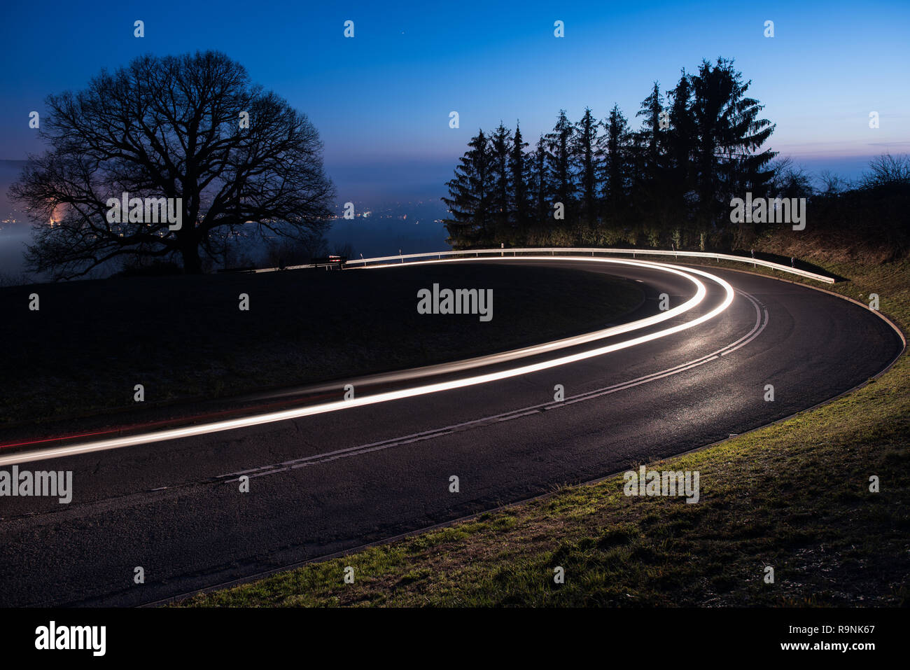 light trails from a car in a curve Stock Photo