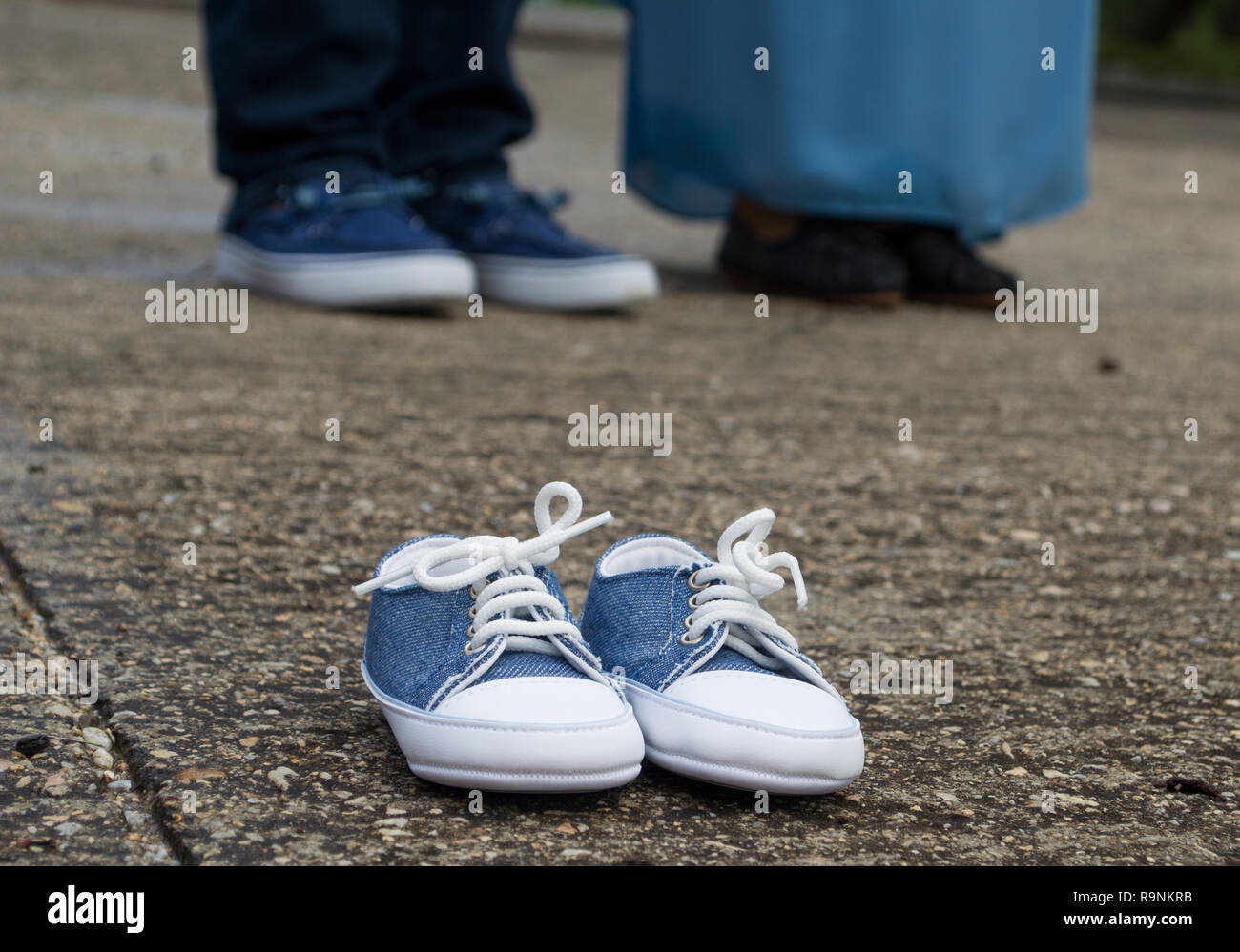 Pregnancy Announcement With Baby Shoes - Stock Image