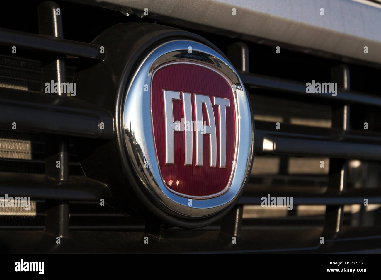 PRAGUE, CZECH REPUBLIC - DECEMBER 13 2018: Fiat automobiles S. p. A. group company logo on car in front of dealership building on December 13, 2018 in Stock Photo