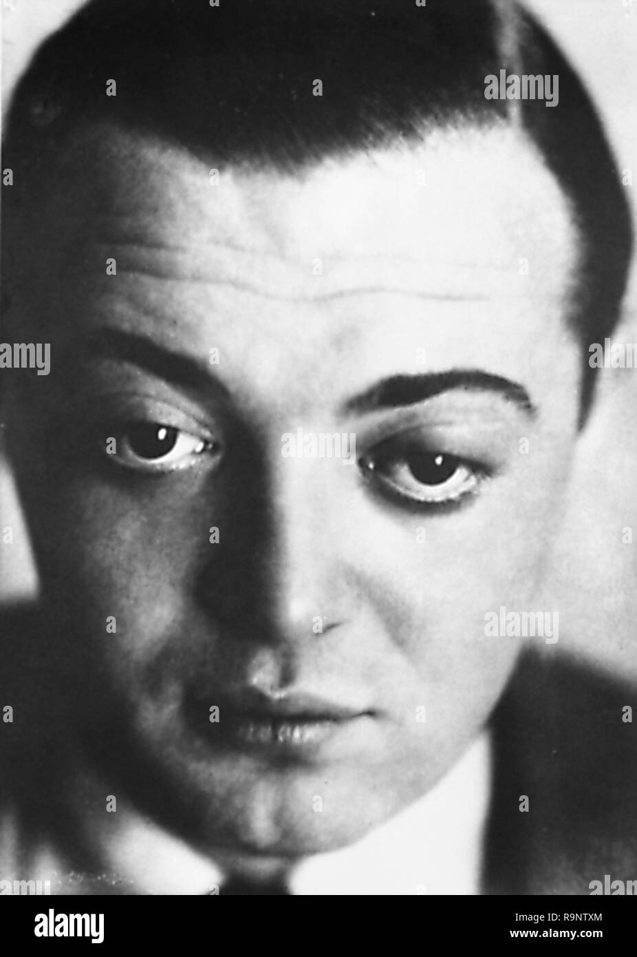Black and white, close-up, headshot photograph of Austro-Hungarian, American actor Peter Lorre (born Lowenstein Laszlo) facing the camera, looking slightly downwards, and furrowing his brow, photographed in Berlin, circa 1930, by the German-American portrait photographer Lotte Jacobi (1896-1990), 1930. () - Stock Image