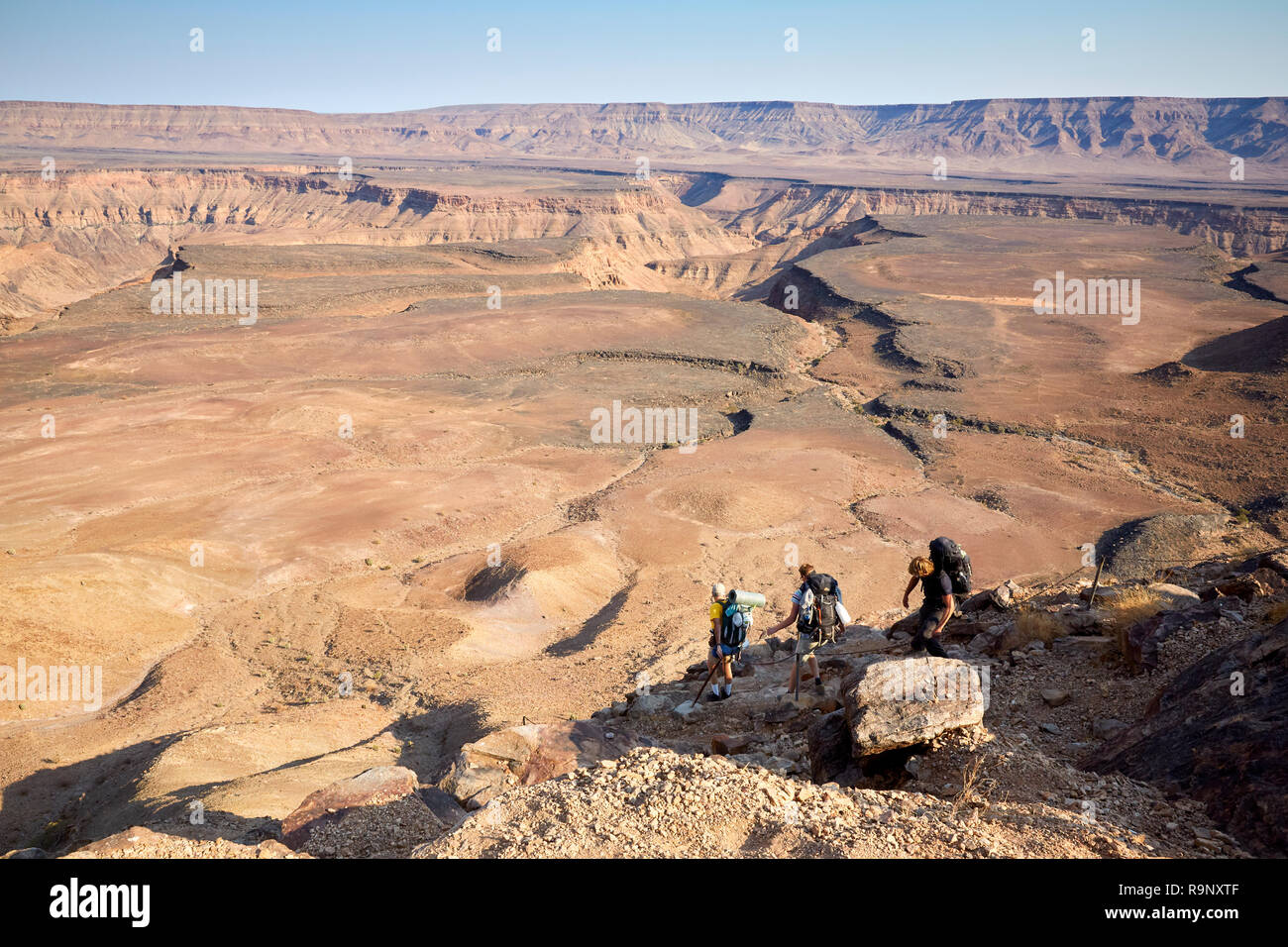 Hikers asdnding into a Fish River Canyon Hiking trekking hikers trekkers in Fish River Canyon, Namibia, Africa - Stock Image