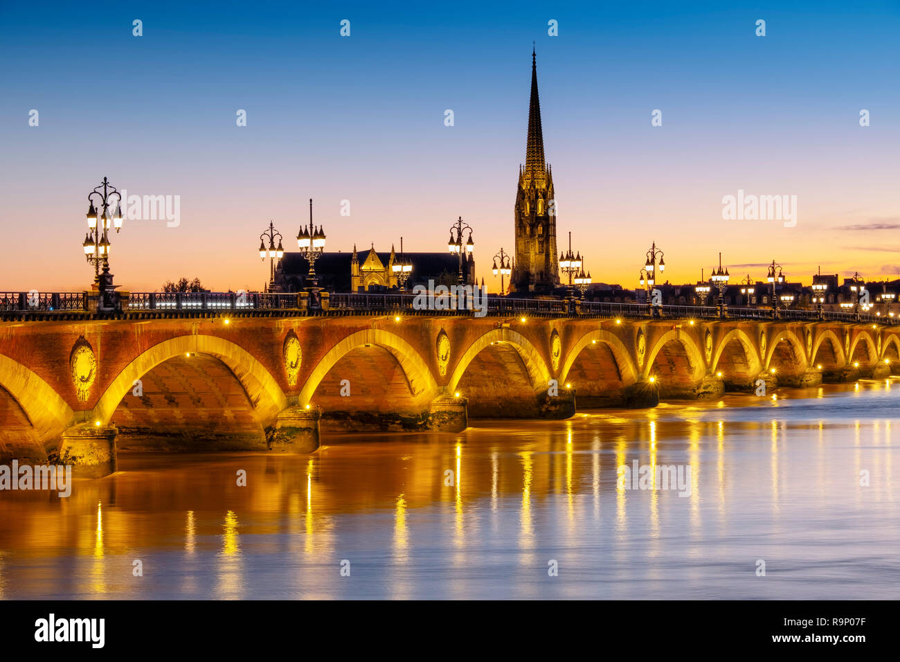 Pont de Pierre at dusk. Stone Bridge & Garonne River. Bordeaux, Gironde. Aquitaine region. France Europe Stock Photo
