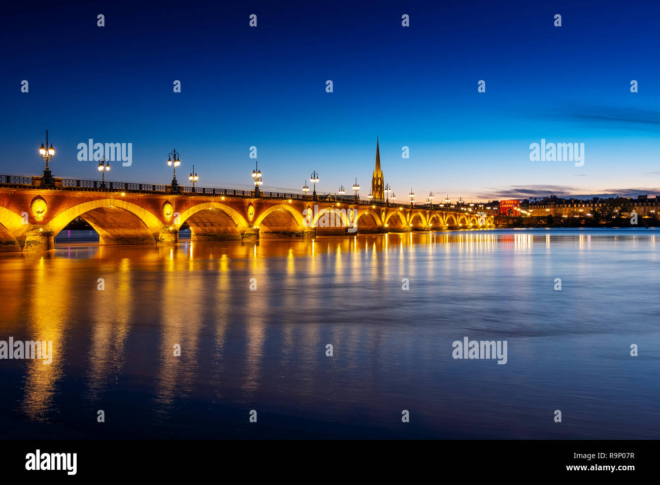 Pont de Pierre at dusk. Stone Bridge & Garonne River. Bordeaux, Gironde. Aquitaine region. France Europe - Stock Image