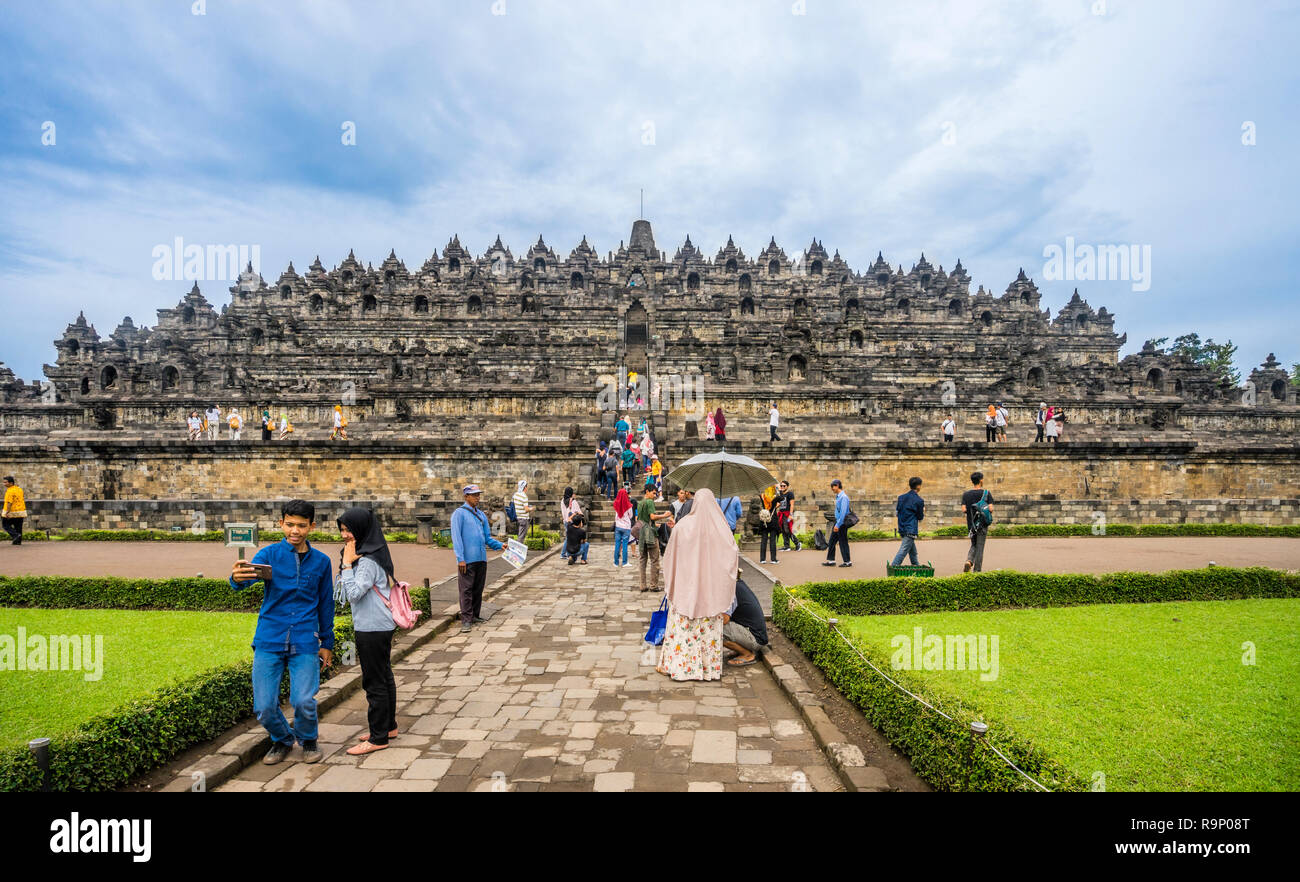 visitors at Candi Borobudur, the 9th century Buddhist temple in Central Java, Indonesia Stock Photo